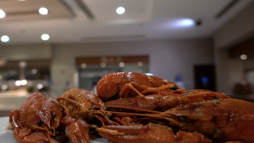 Point of view. The waiter carries a plate of crayfish in the restaurant's hall. Concept of luxury recreation and eating at an expensive resort. | Shutterstock HD Video #1014803543