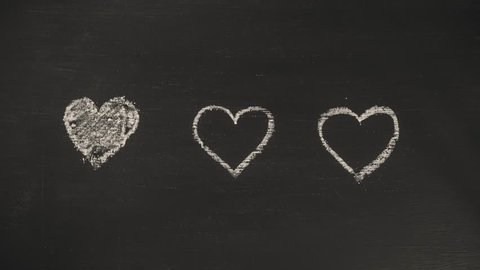 Hand draw Romantic Heart Shape Animation on Chalkboard. 4K Stop Motion Valentines Day Design Background Concept.