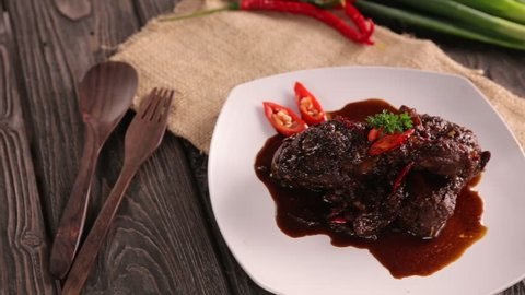 ayam semur. indonesian food of chicken with soysauce and chilli