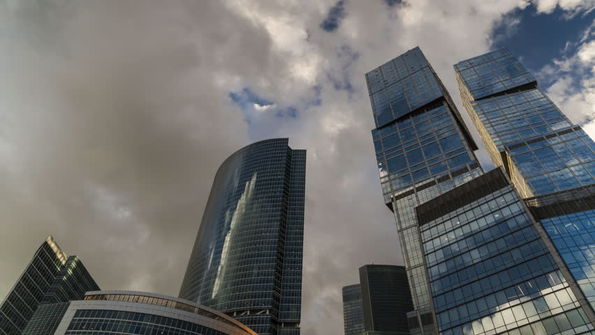 Stock video of bottom up view of rotating skyscrapers and 4k0012bottom up view of rotating skyscrapers and flying cloudstime lapse hyper lapse ccuart Images
