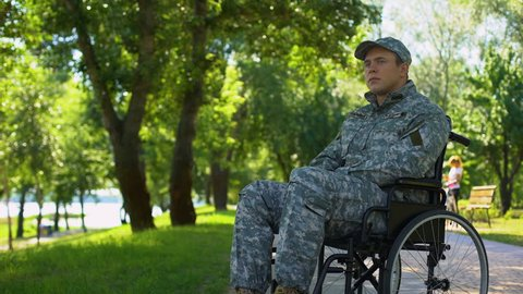 Thoughtful soldier in wheelchair, rehabilitation center, social support program
