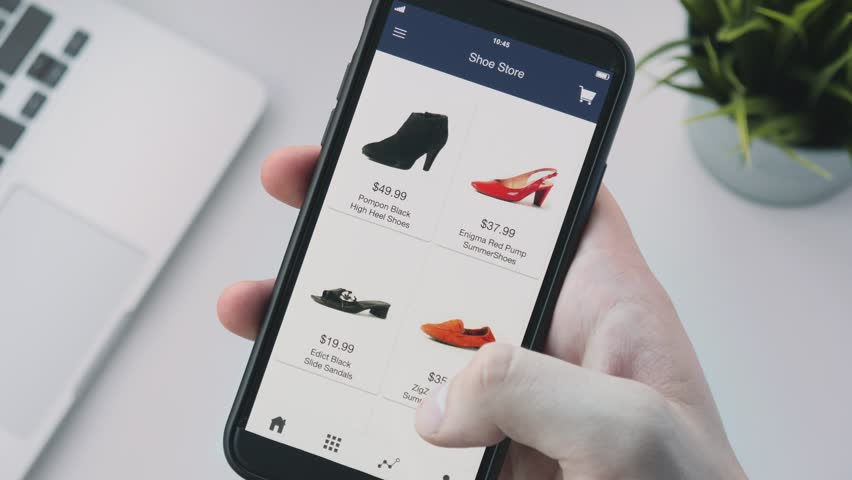 Shopping online using smartphone app and choosing shoes | Shutterstock HD Video #1014847753
