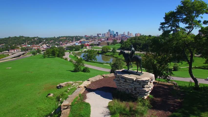 Slow flight over the Kansas City Scout statue reveals the Kansas City skyline.