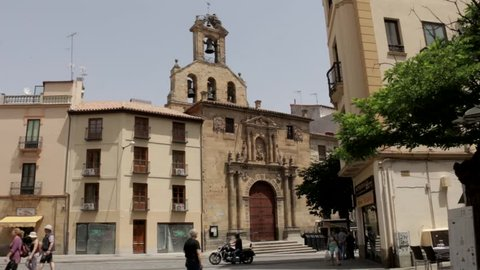 Salamanca, Spain - August 2018: People walking outside San Martin De Tours Church.