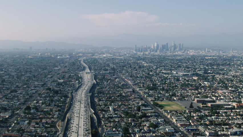Aerial view of downtown Los Angeles during the day. Shot of the 110 highway leading to the downtown district. Shot with a RED camera. 4k footage.