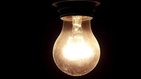 Old light bulb being turned off.