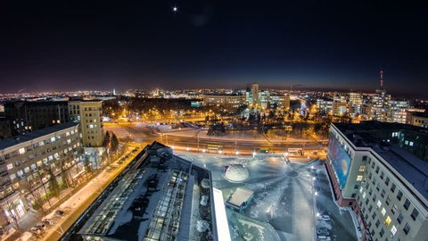 Kharkiv city from above at night winter timelapse. Aerial view of the city center and freedom square. Ukraine.