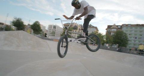 BMX rider in skatepark slowmotion 4K