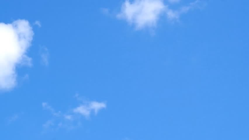 Floating clouds in the blue sky. Time-Lapse video. #1015007173