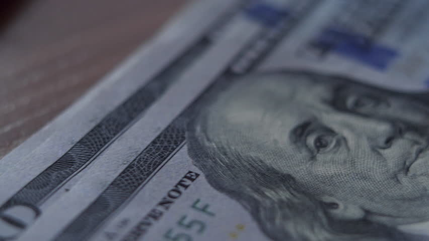 Counting One Hundred Dollars Banknotes On The Table Movement   Shutterstock HD Video #1015011073