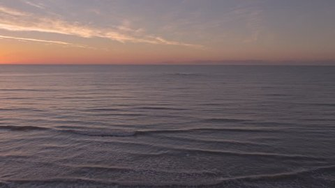 The Eastbourne Coast at sunrise, swooping out over the ocean