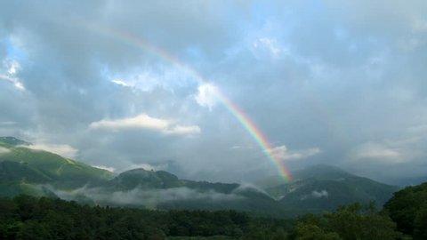 Hakuba mountains with rainbow in Nagano prefecture, Japan. [time lapse]