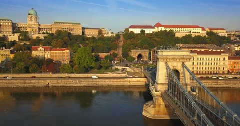 Budapest, Hungary - 4K hyperlapse (time-lapse) footage of beautiful Szechenyi Chain Bridge over River Danube with Buda Castle Royal Palace in the warm morning sunlight