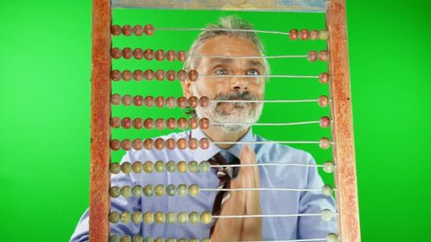 out of focus man behind old abacus, mathematical concept