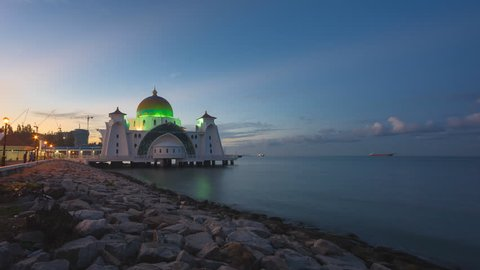 Dramatic Time lapse of sunrise and scattered clouds at a mosque in Melaka, Malaysia at night to day. Full HD 1080p.