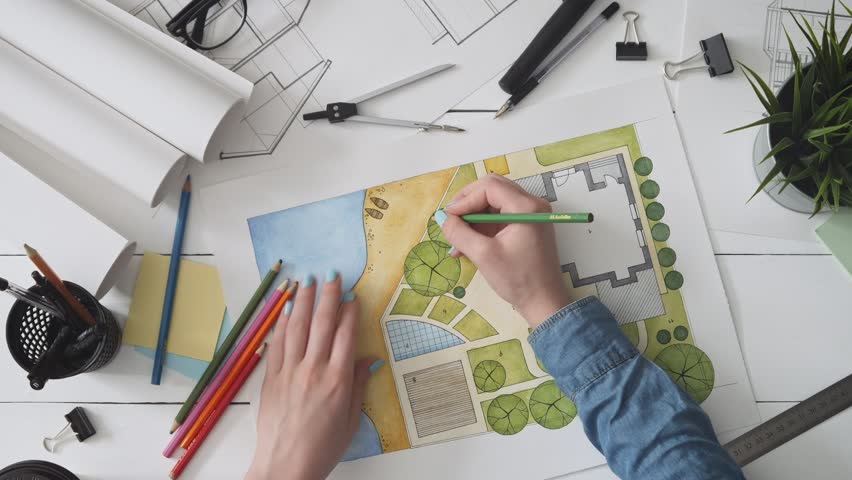 Landscape architect working on a garden design plan | Shutterstock HD Video #1015144603