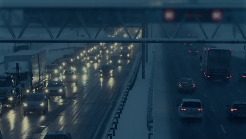 High angle shot on a highway while snowing. | Shutterstock HD Video #1015165303
