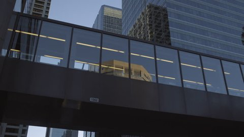 4K Skywalk and Building reflections in Downtown Calgary, Alberta, Canada - sunset,ing shot