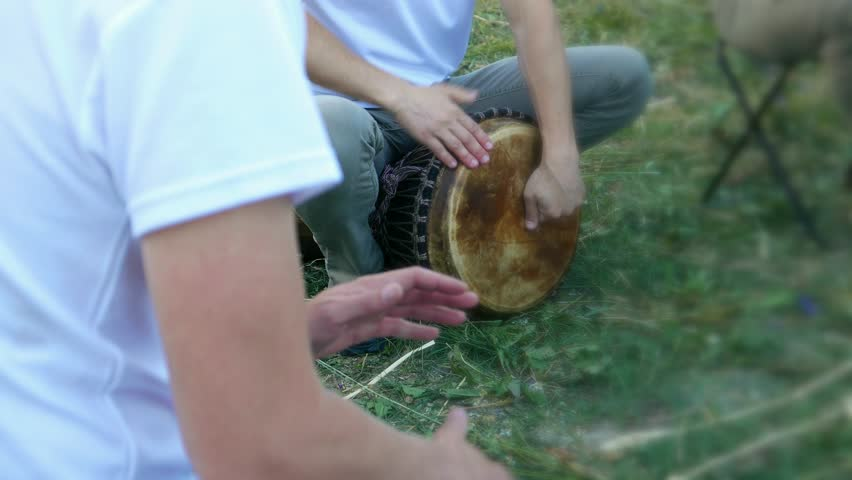 Musicians play percussion instruments. Ethnic drums