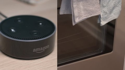 MONTREAL, CANADA - August 2018 : Personal voice assistant turning the oven light ON in the kitchen.Amazon Echo Alexa Dot