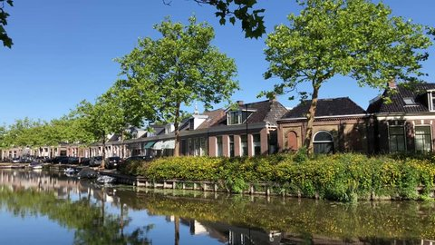 Houses next to the city canal of Bolsward, Friesland The Netherlands