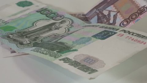Russian money - 1000 and 500 rubles of Russia in motion