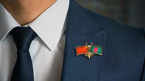 Businessman Walking Towards Camera With Friend Country Flags Pin China - Bangladesh