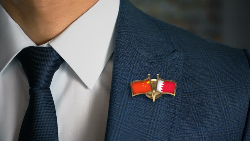 Businessman Walking Towards Camera With Friend Country Flags Pin China - Bahrain