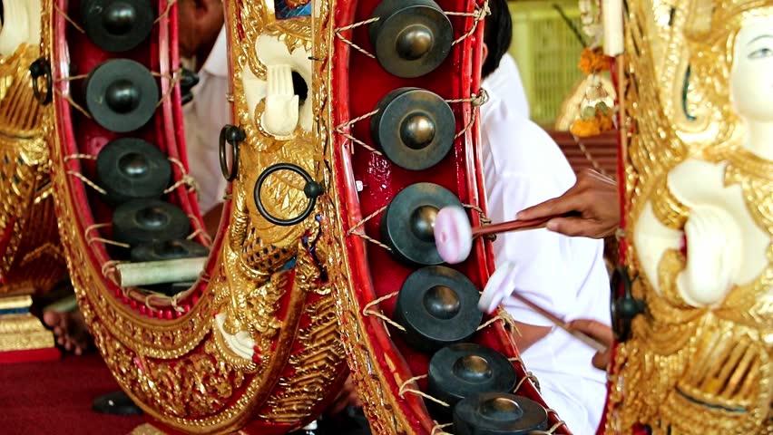 Playing a traditional musical instrument Khong Wong, Thailand. Musician playing on Kong wong - Thai musical instrument.