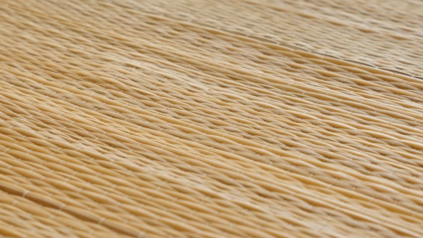 Handmade cattail Typha beach rug surface 4K slow tilt footage