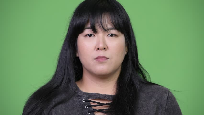 Head shot of beautiful overweight Asian woman smiling | Shutterstock HD Video #1015376353