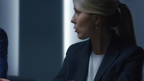 Strong Minded Businesswoman Making a Speech on the Annual Board of Directors Meeting. Serious Businesspeople Negotiating and Talking Business. Shot on RED EPIC-W 8K Helium Cinema Camera.