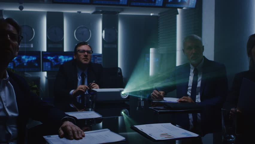 Government Officials, Military Men and Business Executives Watching Presentation in the Conference Room. Working Projector on the Table. Collaboration of Important People. Shot on RED EPIC-W 8K Camera