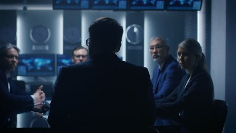 Chief Strategy Officer Making Report to a Board of Directors During Annual Financial Meeting in the conference Room. Shot on RED EPIC-W 8K Helium Cinema Camera.