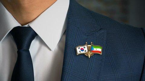 Businessman Walking Towards Camera With Friend Country Flags Pin South Korea - Equatorial Guinea