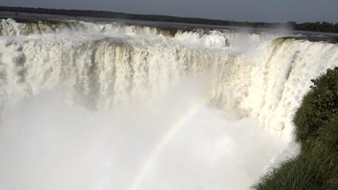 Devil's Throat (Garganta del Diablo) is the biggest of the Iguazu waterfalls, the largest  in the world.  Iguazu Falls located on the Iguazu River on the border of the Argentina and the Brazil .