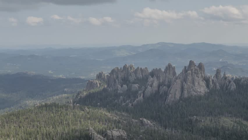 A Medium Shot on the Cathedral Spires Rock Formations in the Black Hills of South Dakota as seen from the Black Elk Peak Vantage Point during a Perfect Summer Day 4K Timelapse