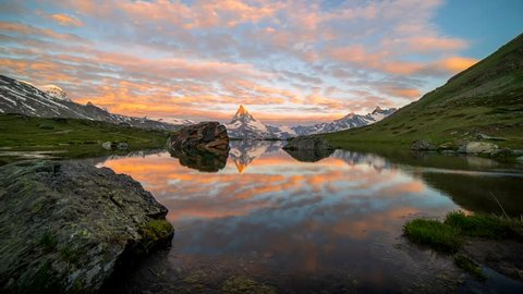 Morning shot of the golden Matterhorn (Monte Cervino, Mont Cervin) pyramid and  blue Stellisee lake. Sunrise view of majestic mountain landscape. Valais Alps, Zermatt, Switzerland, Europe.