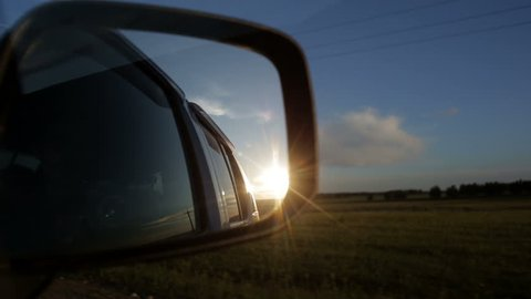 Rear view side mirror in moving car