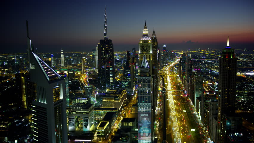 Dubai - March 2018: Aerial night illuminated city view Sheikh Zayed road skyline skyscrapers commercial condominiums vehicle transport highway metro UAE RED WEAPON | Shutterstock HD Video #1015444603