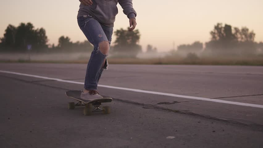 female legs close-up. Girl skateboarding at sunset slow motion. #1015526233