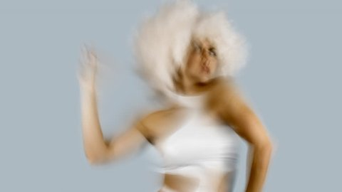 beautiful female dancer in white space costume and large white afro wig. Perfect for stylish club, disco and fashion events