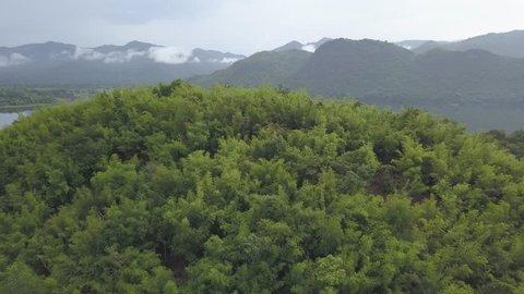 4K Dlog aerial view drone shot over dam lagoon green nature in kanchanaburi, Thailand