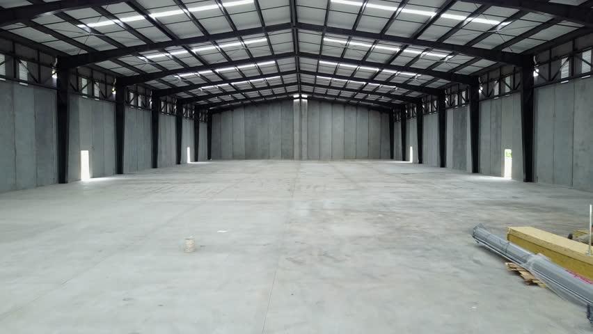 Internal cinematic view of a warehouse  | Shutterstock HD Video #1015630063