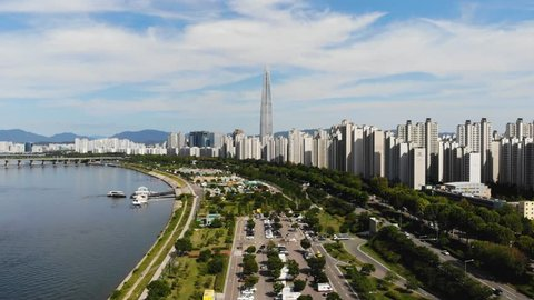 Aerial view cityscape of Seoul, South Korea. Aerial View Lotte tower at Jamsil. View of Seoul with river and mountain. Seoul downtown city skyline, Aerial view of Seoul, South Korea, 08/20/2018