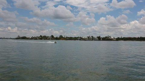 Jet-ski riding on the water, in Sarasota Florida.