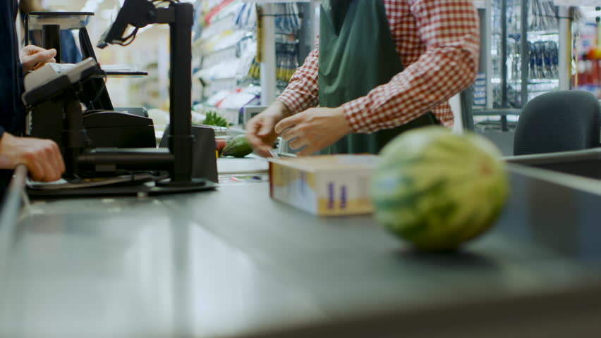 At the Supermarket: Checkout Counter Hands of the Cashier Scans Groceries, Fruits and other Healthy Food Items. Clean Modern Shopping Mall with Friendly Staff, Small Lines and Happy Customers. | Shutterstock HD Video #1015777333