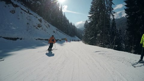 Winter pov of people skiing on slope of famous ski resort Bansko