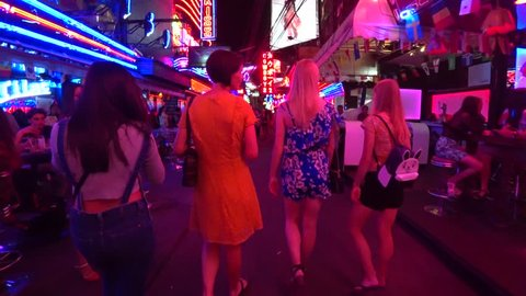 BANGKOK,  THAILAND - CIRCA AUGUST 2018 : View of walking SOI COWBOY street near Asok train station.  This street is famous for night spot.