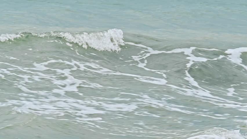 Wave on the sea coast line and a beautiful sandy beach   Shutterstock HD Video #1015876333
